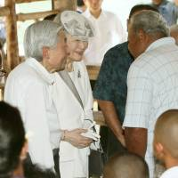 Emperor Akihito and Empress Michiko speak with the people of Peleliu Island on April 9, 2015, during their visit to Palau. | POOL/VIA KYODO