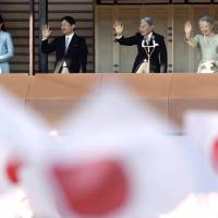 Emperor Akihito, Empress Michiko, Crown Prince Naruhito and Crown Princess Masako wave to well-wishers from a balcony during a New Year's public appearance at the Imperial Palace in Tokyo on Jan. 2, 2014.   AP