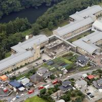 Tsukui Yamayuri En, a care facility for people with disabilities in Sagamihara, Kanagawa Prefecture, is seen from the air Tuesday, hours after a knife-wielding man went on a killing rampage there. | KYODO