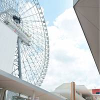 The tallest Ferris wheel in Japan opens for business Friday at Expocity, the new commercial complex in Suita, Osaka. | KYODO