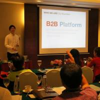 ST Booking founder Shota Morikawa explains his business to agents seeking students who want to study in Japan, at a workshop in Bangkok last November. | COURTESY OF ST BOOKING