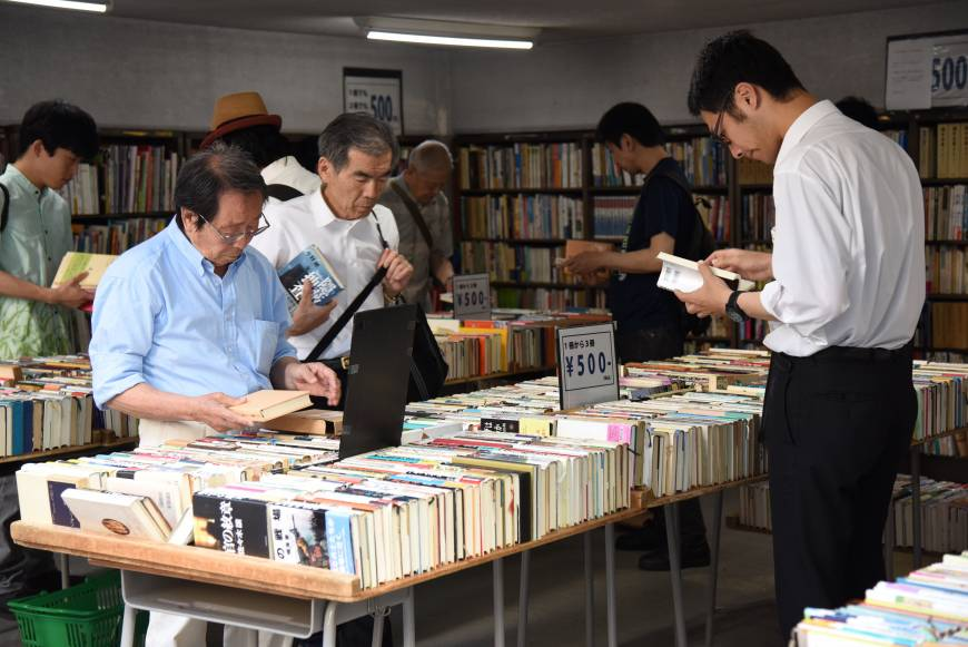 People browse used volumes at one of some 160 bookstores in Jinbocho in Tokyo's Chiyoda Ward.