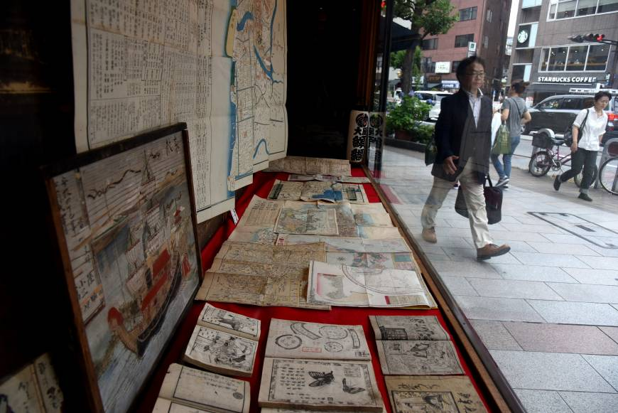 Old maps, ukiyo-e woodblock prints and books from the Edo Period are among valuable antiquarian items offered at the Oya bookstore in Tokyo's Jinbocho district.
