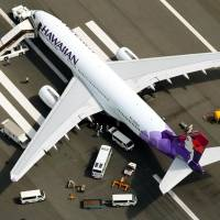 Hawaiian Airlines plane punctures eight tires in emergency landing at Haneda airport
