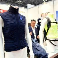 The astronaut-inspired Jaxa Cosmode vest, developed in conjunction with the Japan Aerospace Exploration Agency (JAXA), is displayed at Heat Solution Tokyo 2016 on Wednesday at the Tokyo Big Sight convention center in Koto Ward. | SATOKO KAWASAKI