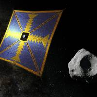 A computer rendering shows what JAXA's solar sail may look like as it approaches an asteroid. The probe is at the sail's center. | JAPAN AEROSPACE EXPLORATION AGENCY