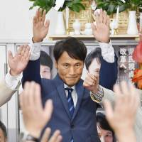 Satoshi Mitazono, a former TV Asahi Corp. commentator, cheers during the Kagoshima gubernatorial election in the city of Kagoshima on Sunday. | KYODO