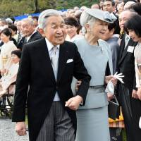 Emperor Akihito and Empress Michiko greet guests during the annual autumn garden party at the Akasaka Palace's Imperial garden in Tokyo last Nov. 12.   AFP-JIJI