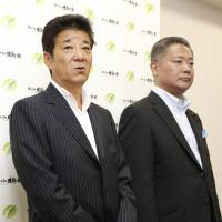 Osaka Ishin no Kai leader Ichiro Matsui answers reporters' questions about a potential name change at the party's headquarters in Osaka on July 12, as Secretary-General Nobuyuki Baba looks on. | KYODO