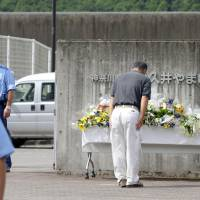 A man bows while paying his respects in front of the Tsukui Yamayuri En care facility in Kanagawa on Thursday where Tuesday's knife attack took place.   KYODO