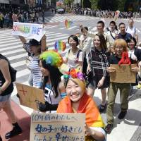 People take part in an LGBT parade organized by Tokyo Rainbow Pride in Shibuya Ward on May 8. | KYODO