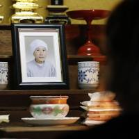 A photo of free diver Yushi Ikeda's late mother, who was an ama free diver, sits in Ikeda's home in Shima, Mie Prefecture, on June 19. He talks to it every day before he goes to work. | KYODO
