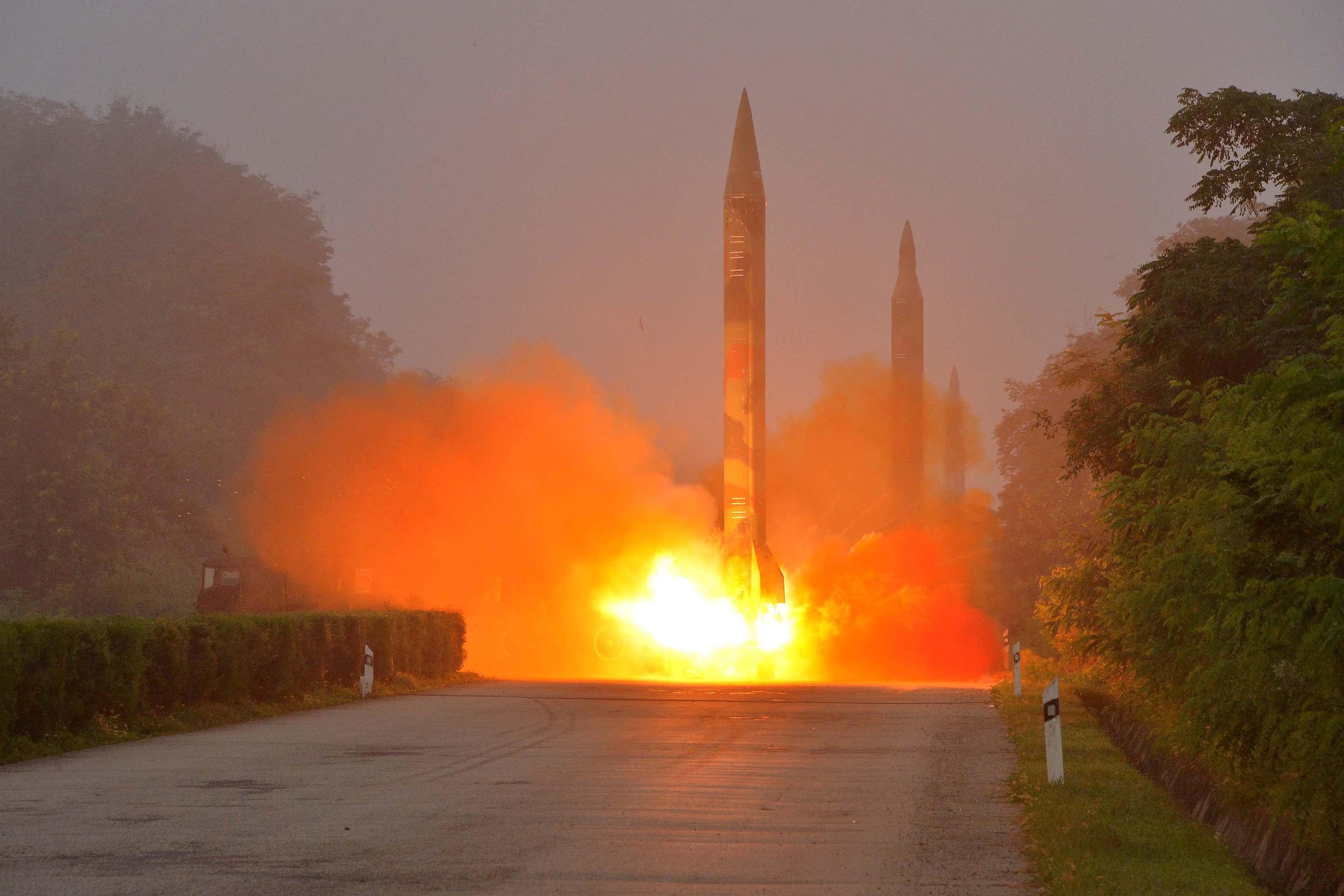 A ballistic rocket is launched during a drill by an artillery unit of the KPA Strategic Force in this undated photo provided by KCNA in Pyongyang on July 21. | REUTERS