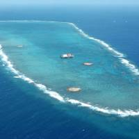 The Okinotorishima atoll is shown in this aerial photo taken in April 2005. | KYODO