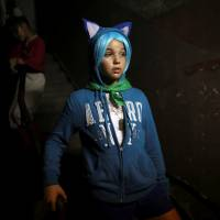 Melissa March, 13, is seen backstage during the Cuban otaku festival held in Havana on Sunday. | REUTERS