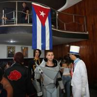 Cosplayers at the Cuban otaku festival's movie theater entrance. Some traveled for hours to attend the event in Havana, Cuba. | REUTERS
