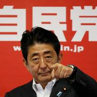 Prime Minister Shinzo Abe, leader of the ruling Liberal Democratic Party, attends a news conference at LDP headquarters in Tokyo on Monday following the ruling bloc's victory in the Upper House election. | REUTERS