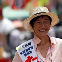 Actress Saya Takagi, a candidate for Shinto Kaikaku (New Renaissance Party), talks with voters in Tokyo's Sugamo district, an area popular with elderly people, on Monday. | REUTERS