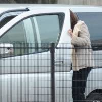 A minor enters a police car in Fukuoka in February without knowing she has agreed to have paid sex with an undercover officer.   KYODO