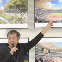 Architect Kengo Kuma talks about his design for the new National Stadium during a news conference on June 24 in Tokyo's Minato Ward. | KYODO
