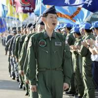 Air Self-Defense Force personnel prepare to board C-130 transport aircraft at Komaki Air Base in Aichi Prefecture on Monday before flying to South Sudan to evacuate Japanese citizens. | KYODO