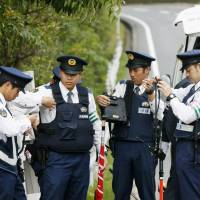 Police officers are deployed to block paths for the main venue of the Group of Seven Ise-Shima Summit in May. The National Police Agency said Friday that it cannot rule out the possibility of Japan becoming a target of terrorist attacks. | KYODO