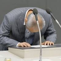 Disgraced Tokyo Gov. Yoichi Masuzoe prepares to announce his resignation to a plenary session of the metropolitan assembly on June 15 amid allegations of improper spending. | KYODO