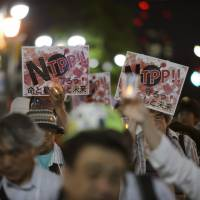People take part in a protest against the Trans-Pacific Partnership trade pact in Tokyo in May.  BLOOMBERG | BLOOMBERG