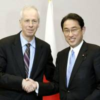 Canadian Foreign Minister Stephane Dion (left) and Foreign Minister Fumio Kishida greet each other in Hiroshima on April 9 ahead of the Group of Seven foreign ministers' meeting. | KYODO