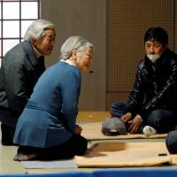 Emperor Akihito Empress Michiko talk with evacuees from the March 11 earthquake and tsunami at the Tokyo Budokan on March 30, 2011. After the Tohoku disaster, the Emperor and Empress visited the region for seven weeks in a row. | REUTERS