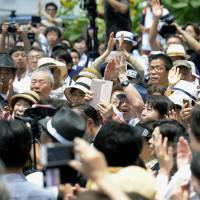 Tokyo voters seek out corruption-free governor