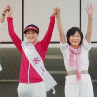 Female candidates running in Sunday's Upper House election take to the street in Kanazawa, Ishikawa Prefecture, on June 11, before official campaigning kicked off. | KYODO
