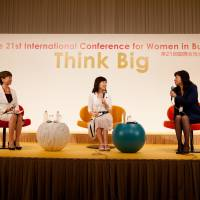 Left to right: Award-winning novelist Main Kohda and Liberal Democratic Party lawmakers Tomomi Inada and Seiko Noda discuss the possibility of a female prime minister in Japan at the 21st International Conference for Women in Business in Tokyo on July 18.   EWOMAN, INC.
