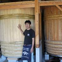 Cedar tubs: Yasuo Yamamoto stands in front of the large kioke (wooden barrels) that he uses to ferment his soy sauce. | NANCY SINGLETON HACHISU