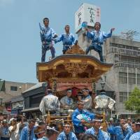 Celebrants on top of a float at the Gion Festival. | STEPHEN MANSFIELD