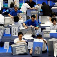 Boxing day: Election officers count votes at a ballot counting center in Tokyo.   REUTERS