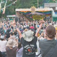 Eco encore: Fans hit the Atomic Cafe stage at a recent Fuji Rock Festival.