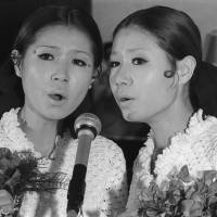 Peanut power: Emi (left) and Yumi Ito formed a pop duo called The Peanuts in postwar Japan. | KYODO
