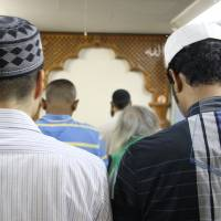 Muslims pray at Otsuka Mosque in Tokyo. Indonesians, Bangladeshis and Pakistanis together account for more than half of the Muslims in Japan. | JARNI BLAKKARLY