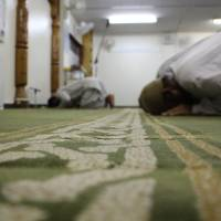 Muslims pray at Otsuka Mosque in Tokyo. An estimated 10 percent of Japan's Muslims are Japanese converts to the faith. | JARNI BLAKKARLY