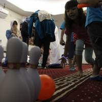 Children play during an Eid al-Fitr celebration at Gyotoku Mosque in Ichikawa, Chiba Prefecture. Around 1,600 of the 72,000 Muslims cited in the documents leaked in 2010 were children attending public schools in Tokyo. | JARNI BLAKKARLY