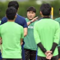 Coach Makoto Teguramori (center) announced his selections for Japan's 18-man squad for the upcoming Rio Olympics on Friday. Japan will play Nigeria in its first match on Aug. 4. | KYODO