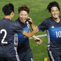 Takuma Asano (center) celebrates after scoring in the Japan Under-23 team's 4-1 win over South Africa on Wednesday. | KYODO