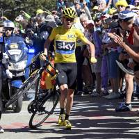 Froome retains lead amid chaos near stage finish line