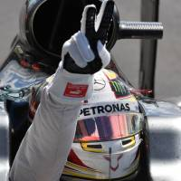Mercedes driver Lewis Hamilton gestures to fans after winning the British Grand Prix on Sunday | AFP-JIJI