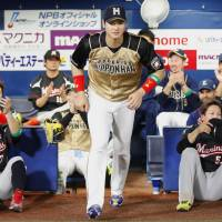 Pacific League designated hitter Shohei Otani of the Fighters heads back on the field for the hero interview after being named MVP of Game 2 of the All-Star Series at Yokohama Stadium on Saturday. Otani had three hits in a game that ended in a 5-5 tie. | KYODO