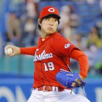 Carp hurler Yusuke Nomura led the Central League with 11 wins prior to the All-Star break. | KYODO
