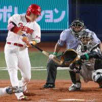 Carp slugger Yoshihiro Maru hits a third-inning home run for the Central League on Saturday. | KYODO