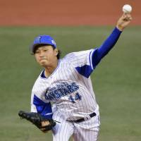Yokohama BayStars lefty Kenta Ishida, the Central League's starter, fires a pitch in Game 2 of the All-Star Series on Saturday. | KYODO