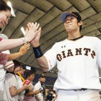 Ota triple lifts Giants to victory over BayStars
